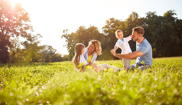 family playing in a field