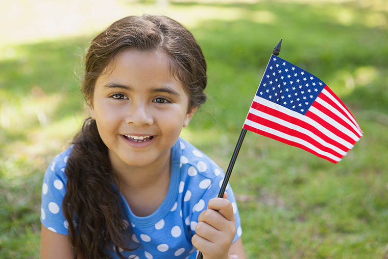 child holding a small US flag