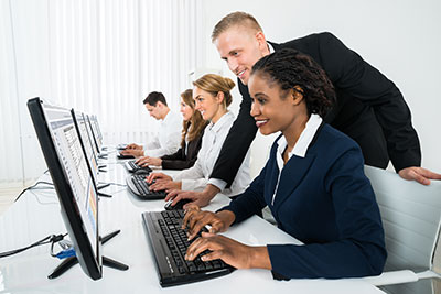 group of people working on computers
