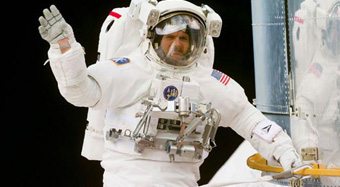 Astronaut waving to the camera in space. Image Credit: American Chemical Society