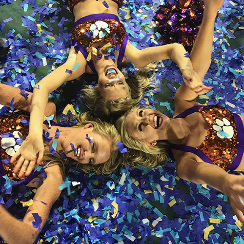 Shannon Corcoran and her fellow Rally Cats celebrate on the field after the national championship game, surrounded by confetti