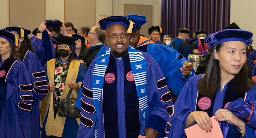 A student shakes the hand of a professional during a job fair at Clemson.