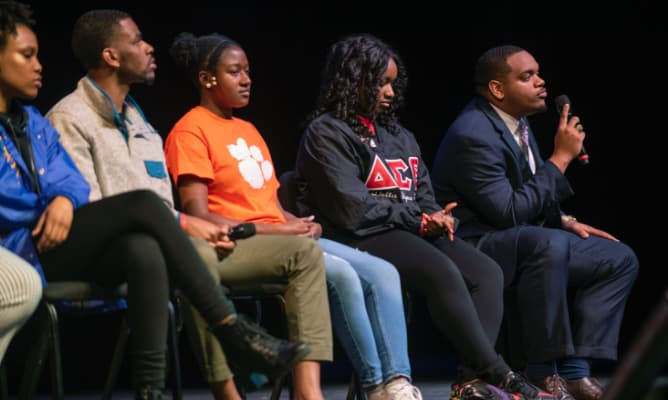 A panel of African American students sit together answering questions during an Experience Clemson event.