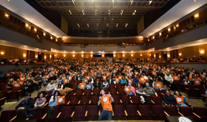 New Clemson students sit in Brooks Performing Arts Center at the beginning of an event.