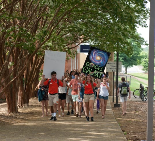 Orientation ambassadors lead their groups of students across campus during a Summer Orientation session.