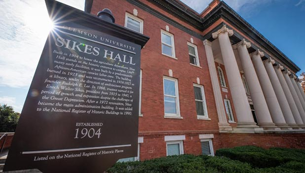 A marker provides historic information about Sikes Hall on Clemson's campus.