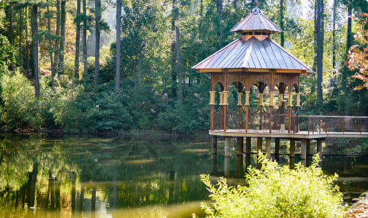 A gazebo sits out over a pond in the South Carolina Botanical Garden.