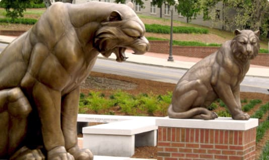 Two Tigers statues guard the entrance to Memorial Park and Scroll of Honor.