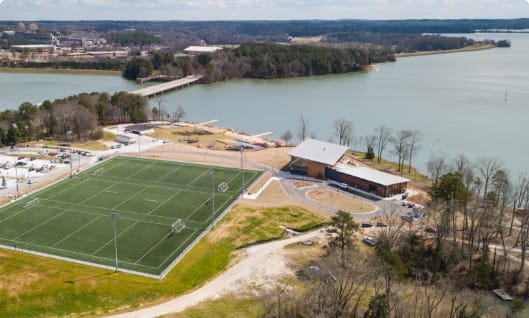 An aerial shot depicts a recreational area beside Lake Hartwell.