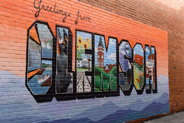 A large mural covers the brick exterior of one of Clemson's downtown businesses.