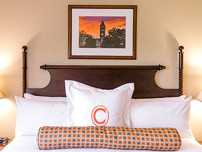 A comfortable, fresh bed sits in one of the rooms in the James F. Martin Inn.