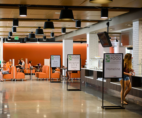 A female student stands in line at the Fresh Food Company, one of Clemson's newest dining halls.