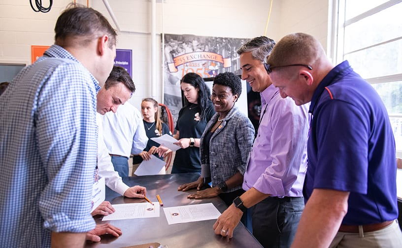 Faculty and staff members work together on a project at Clemson.
