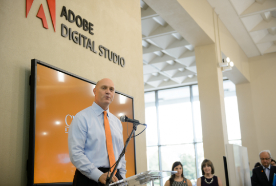 Clemson President Jim Clements addresses industry professionals in the Adobe Digital Studio.