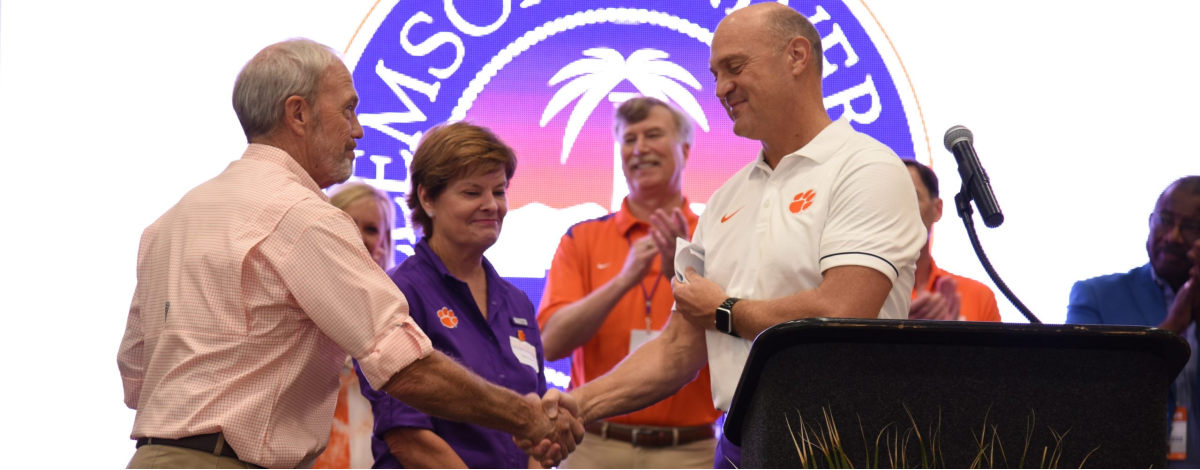 President Clements shaking hands with Mitchell Scott upon receiving $2.5M Academic Cornerstone for Clemson's College of Agriculture, Forestry and Life Sciences to support scholarships