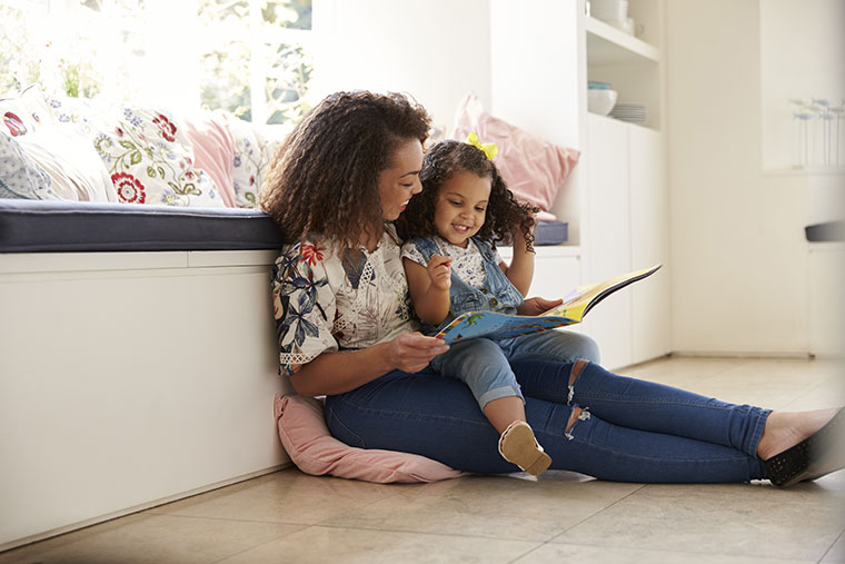 parent reading book with child