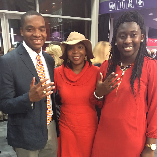 Rayshad posing with his Clemson class ring alongside his family.